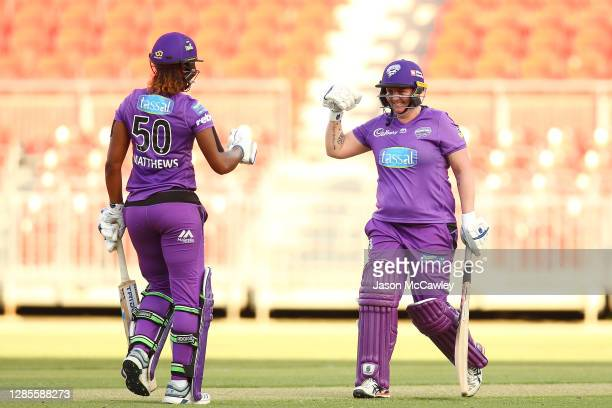 Rachel Priest of the Hurricanes and Hayley Matthews of the Hurricanes celebrate victory during the Women's Big Bash League WBBL match between the...