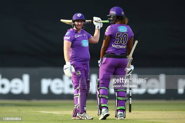 Rachel Priest of the Hurricanes celebrates after reaching her half century during the Women's Big Bash League WBBL match between the Hobart...
