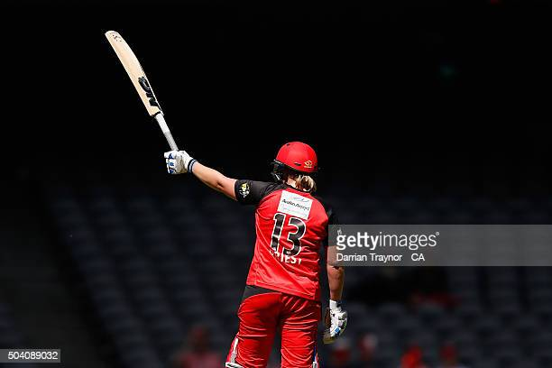 Rachel Priest of the Renegades raises his bat after scoring 50 runs during the Women's Big Bash League match between the Melbourne Renegades and the...