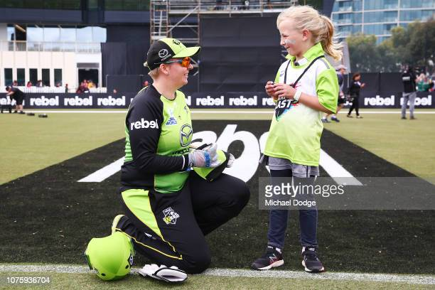 Rachel Priest of the Thunder speaks to a young Thunder fan during the Women's Big Bash League match between the Melbourne Renegades and the Sydney...