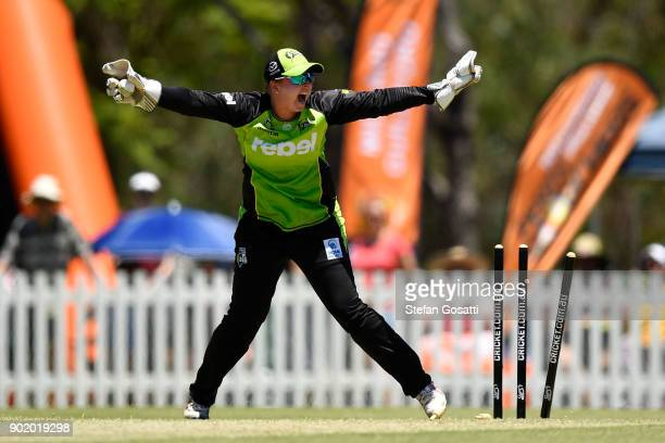Rachel Priest of the Thunder successfully appeals the runout of Mathilda Carmichael of the Scorchers during the Women's Big Bash League match between...