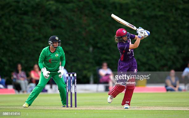 Rachel Priest of Western Storm looks on as Amy Jones of Loughborough Lightning hits out during the Kia Super League women's cricket match between...
