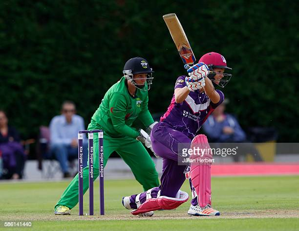 Rachel Priest of Western Storm looks on as Evelyn Jones of Loughborough Lightning hits out during the Kia Super League women's cricket match between...