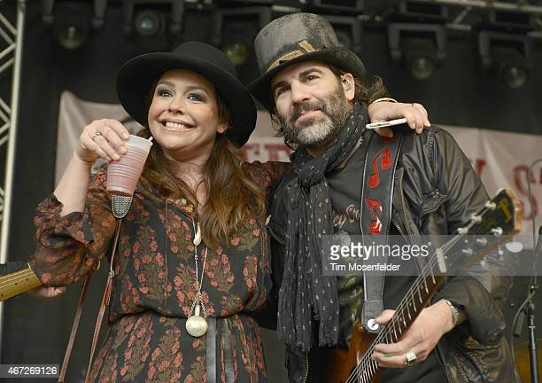 Rachel Ray and John Cusimano of The Cringe greet the audience during the Rachel Ray Feedback Party at Stubbs BarBQue on March 21 2015 in Austin Texas