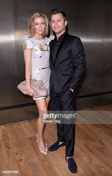 Rachel Riley and Pasha Kovalev attend the Julien Macdonald show during London Fashion Week Spring Summer 2015 on September 13 2014 in London England