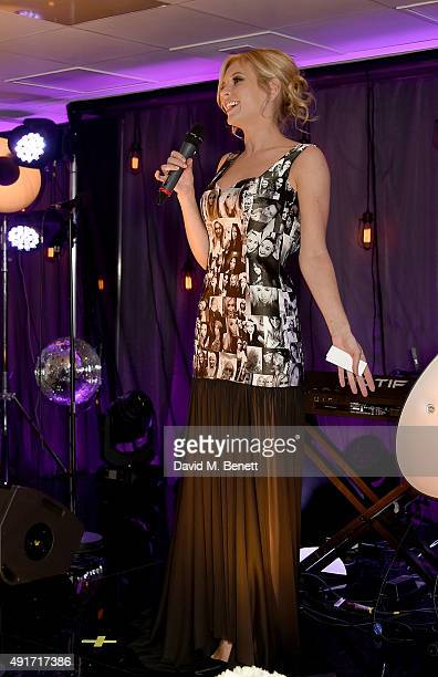 Rachel Riley wears the black and white selfie dress on stage at the Special K Bring Colour Back launch at The Hospital Club on October 7 2015 in...