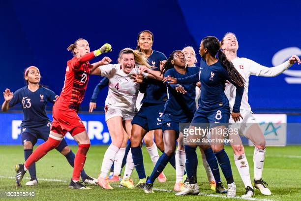 Rachel Rinast of Switzerland fights for position with Goalkeeper Pauline Peyraud-Magnin of France during the friendly match between France and...