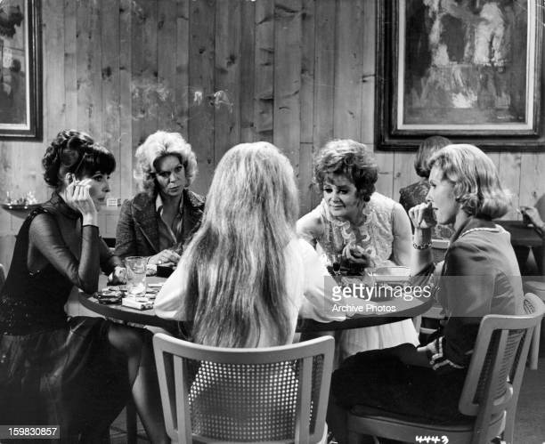 Rachel Roberts Cara Williams and Janice Rule playing cards in a scene from the film 'Doctors' Wives' 1971