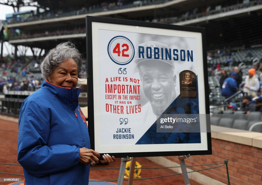 Rachel Robinson, widow of Baseball player Jackie Robinson stands next to a mural of her late husband before the New York Mets play their game against the Milwaukee Brewers at Citi Field on April 15, 2018 in New York City. All players are wearing #42 in honor of Jackie Robinson Day.