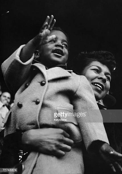 Rachel Robinson wife of Brooklyn Dodgers baseball player Jackie Robinson and their son Jackie Jnr at the Polo Grounds during the Memorial Day...