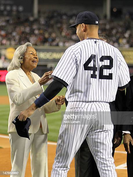 Rachel Robinson wife of Jackie Robinson welcomes Derek Jeter of the New York Yankees to an on field ceremony prior to their game against the Los...