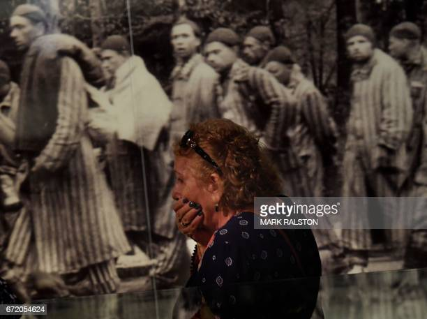 Rachel Sokolovski who is the widow of a Holocaust survivor reacts while viewing photographs at the Los Angeles Museum of the Holocaust after a...