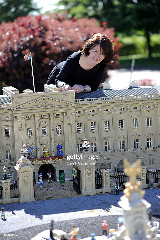 Rachel Trevor-Morgan, The Queen's milliner arranges LEGO figures of Camilla, Duchess of Cornwall, Queen Elizabeth II, Catherine, Duchess of Cambridge, Princess Beatrice, Princess Eugenie, Zara Tindall and Carole Middleton outside a LEGO Buckingham Palace ahead of Royal Ascot at LEGOLAND Windsor on June 10, 2014 in Windsor, England.