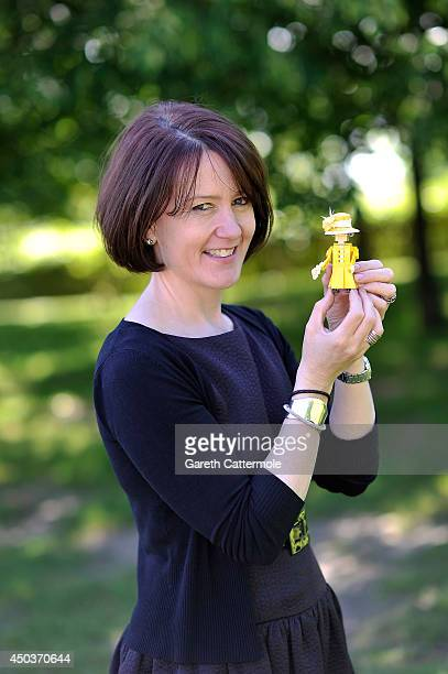 Rachel TrevorMorgan The Queen's milliner holds a LEGO figure of Queen Elizabeth II wearing one of her creations ahead of Royal Ascot at LEGOLAND...