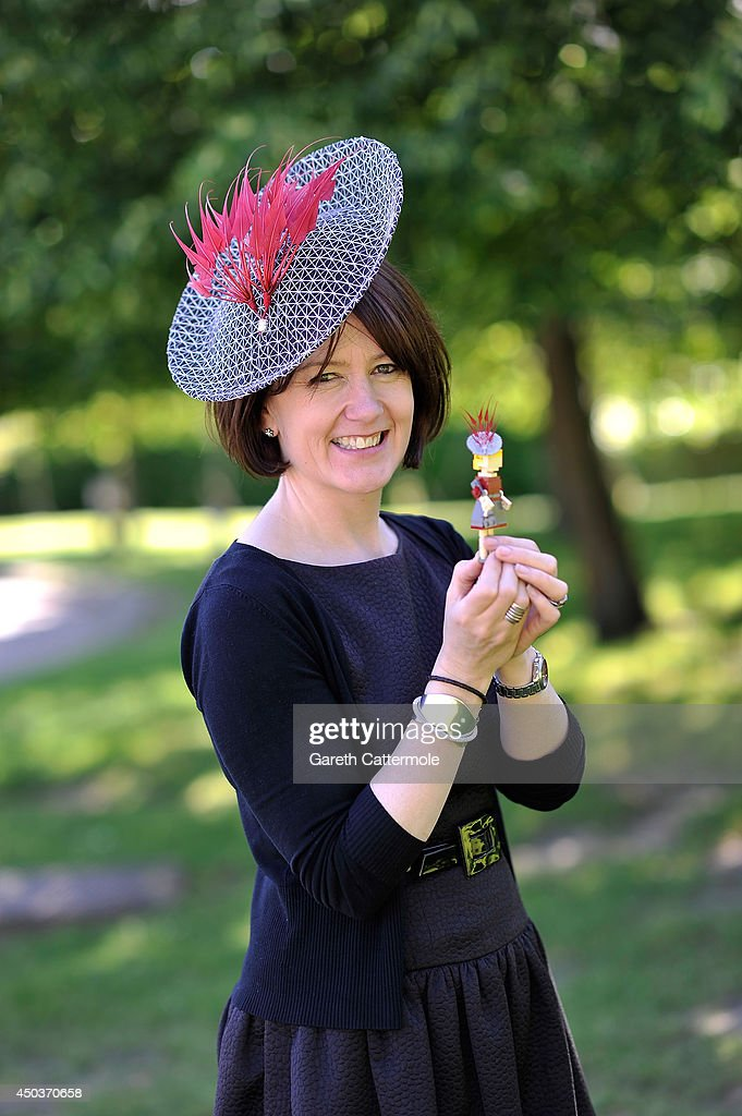 Rachel Trevor-Morgan, The Queen's milliner holds a LEGO figure of Zara Tindall wearing one of her creations ahead of Royal Ascot at LEGOLAND Windsor on June 10, 2014 in Windsor, England.