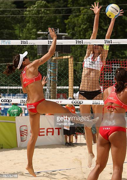 Rachel Wacholder of USA spikes the ball as Virginie Sarpaux of France attempts to block during day four of the FIVB 2007 Beach Volleyball World...