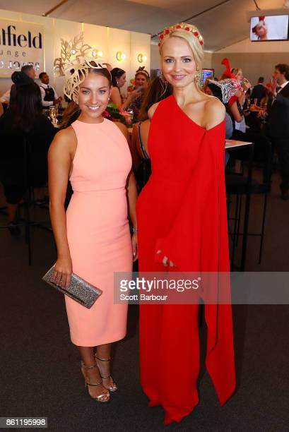 Rachel Watts and Jane Scandizzo from the 'Yummy Mummies' television series attend the David Jones Marquee during Melbourne Racing on Caulfield...