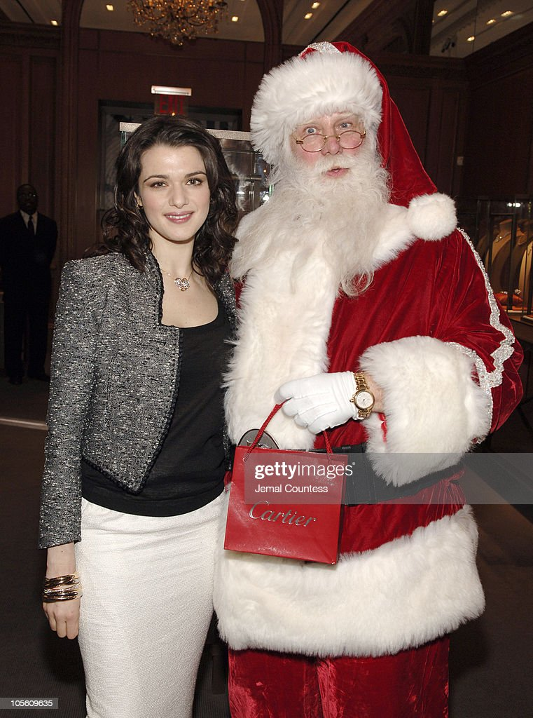 Rachel Weisz and the Cartier Santa during Rachel Weisz Hosts the Cartier Red Bow Unveiling to Kick Off the Holiday Season at Cartier Boutique in New York City, New York, United States.