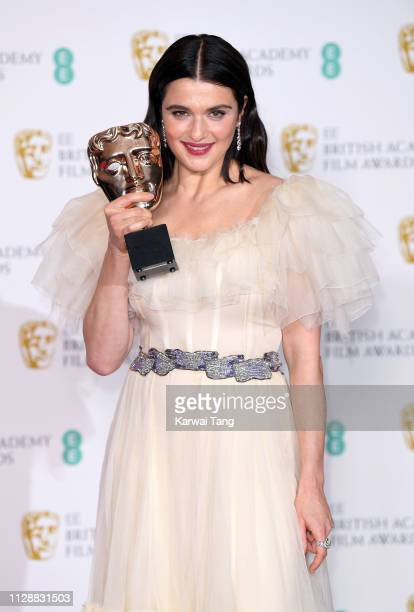 Rachel Weisz, winner of Best Supporting Actress for The Favourite poses with her award in the press room during the EE British Academy Film Awards at...