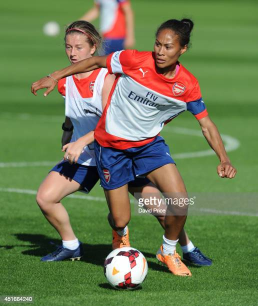 Rachel Yankey and Christie Murray of Arsenal Ladies during their training session at London Colney on July 3 2014 in St Albans England