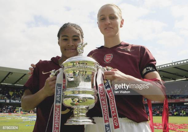 Rachel Yankey and Faye White of Arsenal Ladies celebrates after winning the Womens FA Cup Final match between Leeds United Ladies v Arsenal Ladies at...