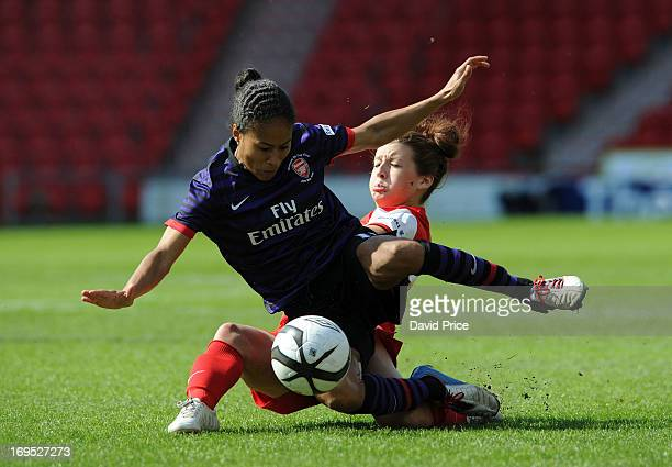 Rachel Yankey of Arsenal Ladies falls in a challenge by Angharad James of Bristol Academy during The FA Women's Cup Final match between Bristol...