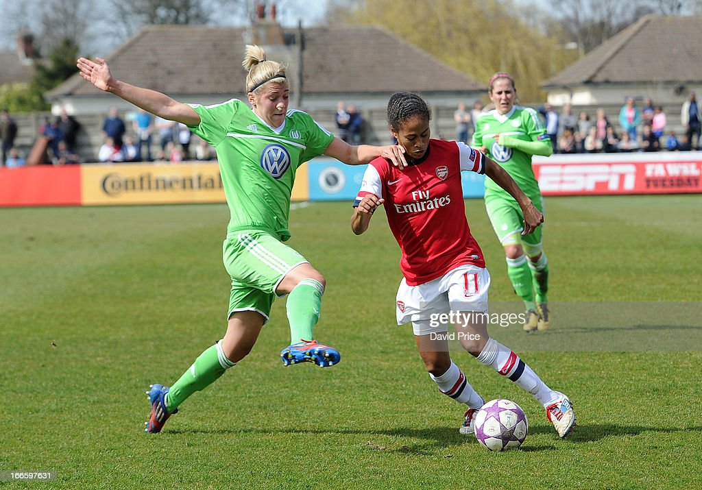Rachel Yankey of Arsenal Ladies FC is fouled by Luisa Wensing of Wolfsburg during the Women's Champions League Semi Final match between Arsenal Ladies FC and VfL Wolfsburg at Meadow Park on April 14, 2013 in Borehamwood, United Kingdom.