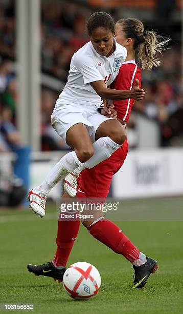 Rachel Yankey of England avoids the challenge from Guican Koca during the FIFA Womens World Cup Qualifiying match between England and Turkey at the...