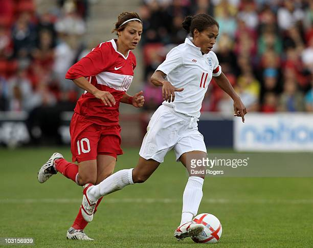 Rachel Yankey of England races away from Eylul Elgalp during the FIFA Womens World Cup Qualifiying match between England and Turkey at the Banks's...
