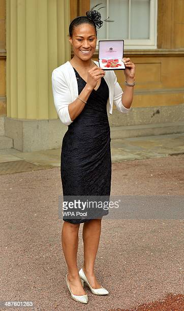 Rachel Yankey poses with her MBE for services to football after she was awarded it by Princess Anne Princess Royal at an Investiture ceremony at...