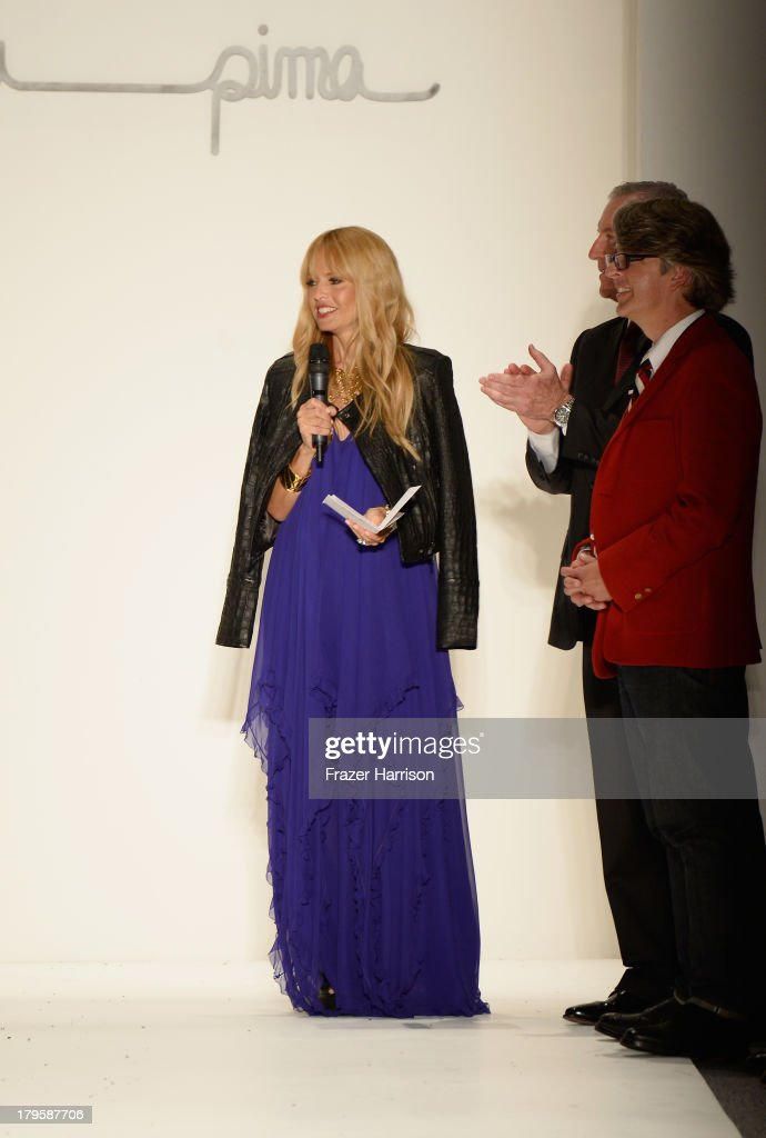 Rachel Zoe, Supima President Jesse Curlee and Vice President of Marketing Buxton Midyette speak on the runway at the Supima Spring 2014 fashion show during Mercedes-Benz Fashion Week at The Studio at Lincoln Center on September 5, 2013 in New York City.