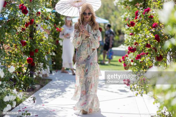 Rachel Zoe wearing a dress with floral print during day 2 of the 2017 Coachella Valley Music Arts Festival Weekend 1 on April 15 2017 in Indio...