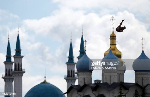 Rachelle Simpson of the US competes in front of the Blagoveshchensk cathedral and the KulSharif mosque to win the Women's High Diving 20 m final at...