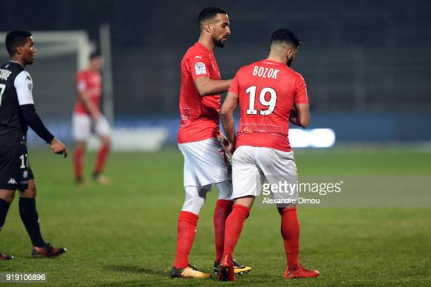 Rachid Alioui and Umut Bozok of Nimes during the French Ligue 2 match between Nimes and Tours at Stade des Costieres on February 16 2018 in Nimes...