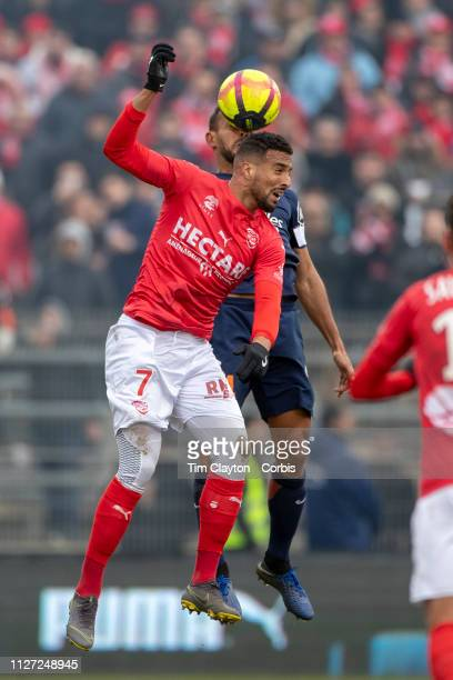 Rachid Alioui of Nimes and Vitorino Hilton of Montpellier challenge for the ball during the Nimes V Montpellier French Ligue 1 regular season match...