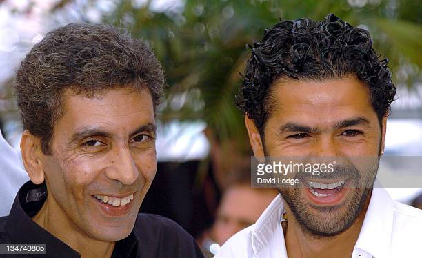 Rachid Bouchareb and Jamel Debbouze during 2006 Cannes Film Festival 'Indigenes' Photocall at Palais des Festival in Cannes France
