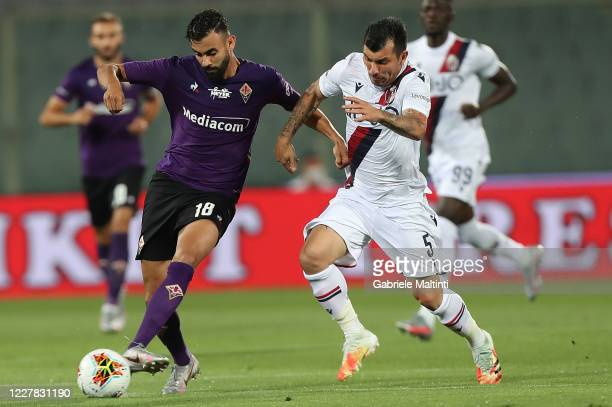Rachid Ghezzal of ACF Fiorentina battles for the ball with Gary Medel of Bologna FC during the Serie A match between ACF Fiorentina and Bologna FC at...
