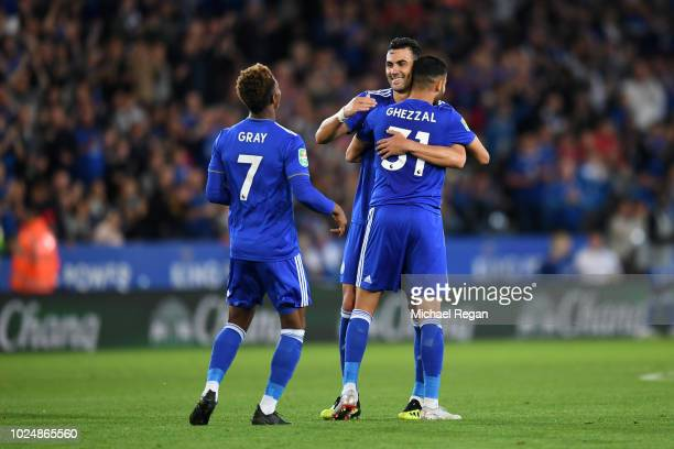 Rachid Ghezzal of Leicester City celebrates with team mate Vicente Iborra of Leicester City after scoring his team's fourth goal during the Carabao...