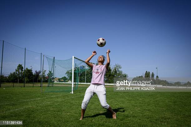 Rachida Majri twin sister of France's defender Amel Majri shows off her skills on a football pitch on June 19 2019 in Genas near Lyon France's...