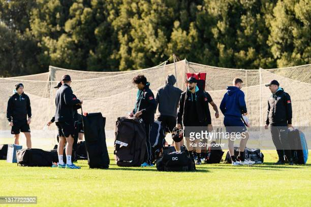 Rachin Ravindra and Daryl Mitchell walk from the ground at the end of a New Zealand Blackcaps training session at the New Zealand Cricket High...