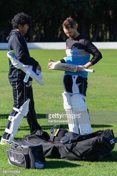 Rachin Ravindra and Devon Conway look on during a New Zealand Blackcaps training session at the New Zealand Cricket High Performance Centre on May...