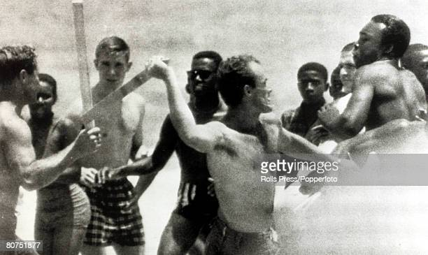 Racial Discrimination Segregation USA pic 22nd June 1964 StAugustine Florida Black demonstrators attempting to swim in the Atlantic Ocean on a white...