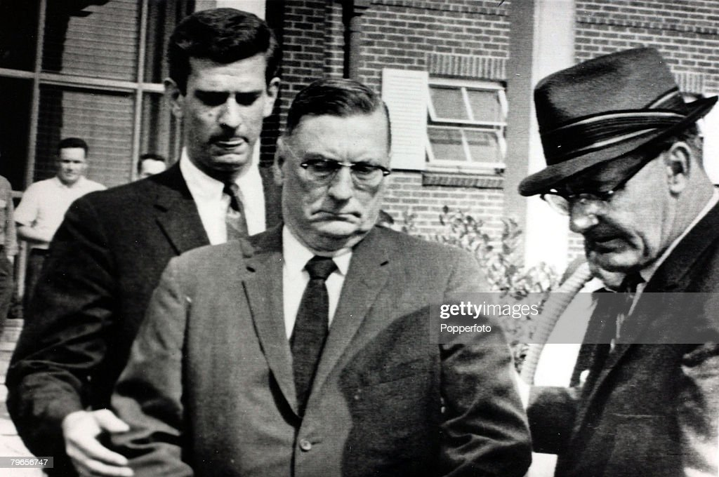 26th September 1962, Oxford, Mississippi, State Governor Ross Barnett, centre, is led away after trying to block the entry of black student James Meredith to the University of Mississippi