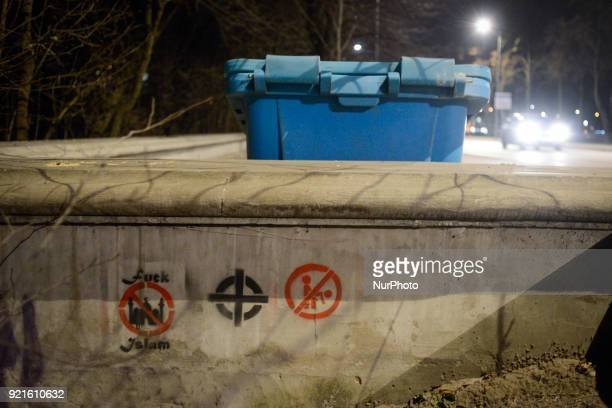 Racial xenophobic and homophobic slogans are seen painted on a wall near the National Stadium in Warsaw Poland on February 20 2018