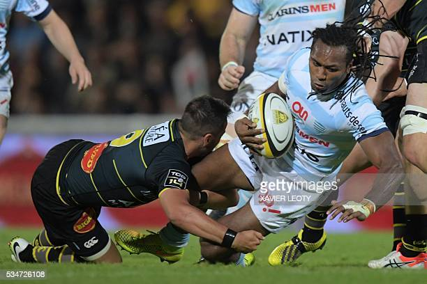 Racing 92's Albert Vulivuli is tackled by La Rochelle's Julien Audy during the French Top 14 rugby union match La Rochelle vs Racing 92 on May 27...