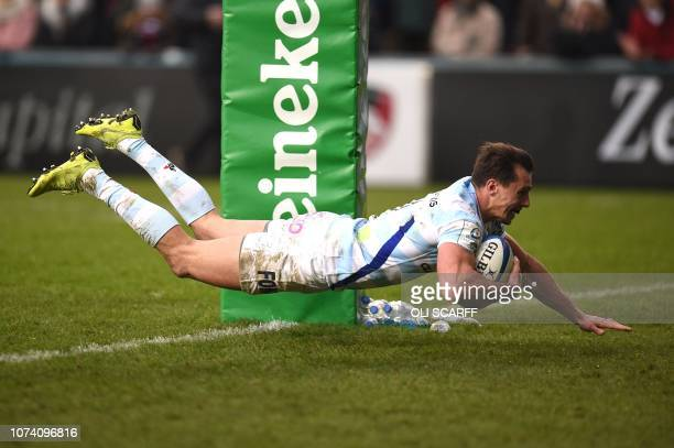 Racing 92's Argentinian wing Juan Imhoff scores his team's fourth try his second during the European Champions Cup Pool 4 rugby union match between...