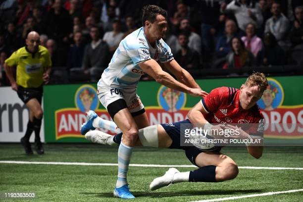 Racing 92's Argentinian wing Juan Imhoff vies with Munster's English-born Irish full-back Mike Haley during the European Champions Cup rugby union...