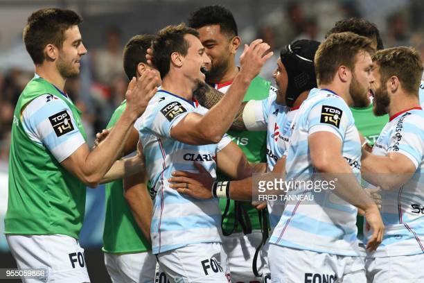 Racing 92's Argentinian winger Juan Imhoff celebrates with teammates after scoring during the French Top 14 rugby union match between Racing 92 and...