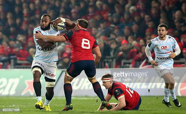 Racing 92's Fijian lock Leone Nakarawa is tackled by Munster's South Africanborn Irish number 8 CJ Stander during the European Rugby Champions Cup...