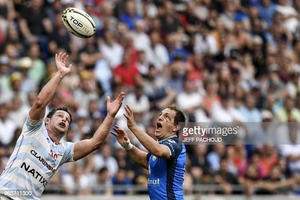 Racing 92's French centre Henry Chavancy vies with Castres' French fly-half Benjamin Urdapilleta during the French Top 14 rugby union semi-final...